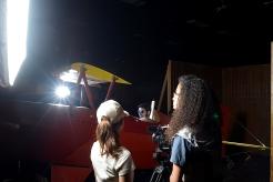 CNM Film Technician students Kandice Montoya (left), Benjamin Ginsburg (center) and Breauna Choy (right) work on a mock video shoot.
