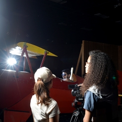 CNM Film Technician students Kandice Montoya (left), Benjamin Ginsburg (center) and Breauna Choy (right) work on a mock video shoot.