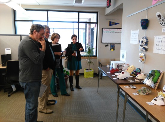 The death mask display draws a crowd of instructors in the faculty offices at Montoya campus.
