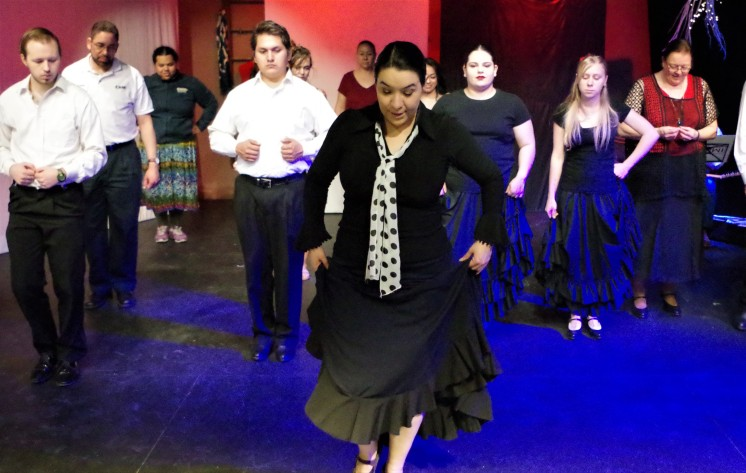 With the help of her Flamenco 1 students Brigit Lujan (front center), teaches the audience members some beginning Flamenco steps. (Hilary Broman/ CNM Chronicle).
